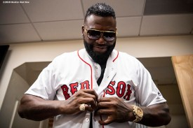 BOSTON, MA - SEPTEMBER 9: Former designated hitter David Ortiz #34 of the Boston Red Sox puts on a jersey before throwing out a ceremonial first pitch as he returns to Fenway Park before a game against the New York Yankees on September 9, 2019 at Fenway Park in Boston, Massachusetts. (Photo by Billie Weiss/Boston Red Sox/Getty Images) *** Local Caption *** David Ortiz