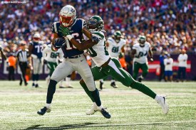 FOXBOROUGH, MA - SEPTEMBER 22: Jakobi Meyers #16 of the New England Patriots carries the ball as he is pursued by Marcus May #20 of the New York Jets during the third quarter of a game at Gillette Stadium on September 22, 2019 in Foxborough, Massachusetts. (Photo by Billie Weiss/Getty Images) *** Local Caption *** Jakobi Meyers; Marcus May