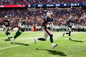 FOXBOROUGH, MA - SEPTEMBER 22: Devin McCourty #32 of the New England Patriots carries the ball after intercepting a pass during the third quarter of a game against the New York Jets at Gillette Stadium on September 22, 2019 in Foxborough, Massachusetts. (Photo by Billie Weiss/Getty Images) *** Local Caption *** Devin McCourty