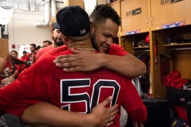 BOSTON, MA - SEPTEMBER 29: Mookie Betts #50 of the Boston Red Sox hugs Eduardo Rodriguez #57 after scoring the game winning run on a walk-off single hit by Rafael Devers #11 during the ninth inning of a game against the Baltimore Orioles on September 29, 2019 at Fenway Park in Boston, Massachusetts. (Photo by Billie Weiss/Boston Red Sox/Getty Images) *** Local Caption *** Mookie Betts; Eduardo Rodriguez