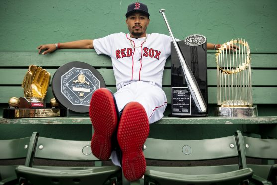 April 12, 2019 , Boston, MA: Boston Red Sox right fielder Mookie Betts poses for a portrait with his 2018 Rawlings Gold Glove Award, 2018 Major League Baseball American League Most Valuable Player Award, 2018 Louisville Slugger Silver Slugger Award, and 2018 World Series trophy at Fenway Park in Boston, Massachusetts Friday, April 12, 2019. (Photo by Billie Weiss/Boston Red Sox)