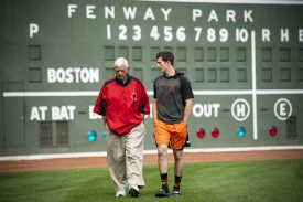 BOSTON, MA - SEPTEMBER 17: Former Boston Red Sox left fielder Carl Yastrzemski walks away from the Green Monster with his grandson Mike Yastrzemski #5 of the San Francisco Giants during the filming of an MLB Network segment on September 17, 2019 at Fenway Park in Boston, Massachusetts. (Photo by Billie Weiss/Boston Red Sox/Getty Images) *** Local Caption *** Mike Yastrzemski; Carl Yastrzemski