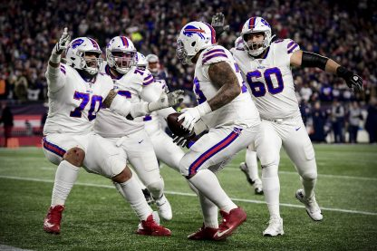FOXBOROUGH, MASSACHUSETTS - DECEMBER 21: Dion Dawkins #73 of the Buffalo Bills celebrates catching a touchdown pass during the second quarter against the New England Patriots in the game at Gillette Stadium on December 21, 2019 in Foxborough, Massachusetts. (Photo by Billie Weiss/Getty Images)