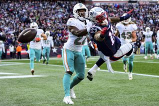 FOXBOROUGH, MA - DECEMBER 29: Tae Hayes #22 of the Miami Dolphins breaks up a pass intended for NÕKeal Harry #15 of the New England Patriots during the second quarter of a game at Gillette Stadium on December 29, 2019 in Foxborough, Massachusetts. (Photo by Billie Weiss/Getty Images) *** Local Caption *** Tae Hayes; NÕKeal Harry