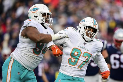 FOXBOROUGH, MA - DECEMBER 29: Trent Harris #97 reacts alongside Christian Wilkins #94 after a sack during the fourth quarter of a game against the New England Patriots at Gillette Stadium on December 29, 2019 in Foxborough, Massachusetts. (Photo by Billie Weiss/Getty Images) *** Local Caption *** Trent Harris; Christian Wilkins