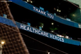 BOSTON, MA - APRIL 9: The signage displays a message as medical professionals from Beth Israel Deaconess Medical Center are welcomed onto the empty field at Fenway Park in recognition of their work during the coronavirus pandemic on April 9, 2020 at Fenway Park in Boston, Massachusetts. The welcoming was filmed for the 'Some Good News With John Krasinski' YouTube series. (Photo by Billie Weiss/Boston Red Sox/Getty Images) *** Local Caption ***