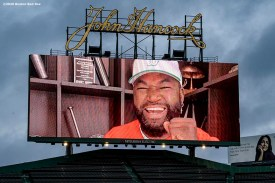 BOSTON, MA - APRIL 9: The scoreboard displays a video message from former Boston Red Sox designated hitter David Ortiz as medical professionals from Beth Israel Deaconess Medical Center are welcomed onto the empty field at Fenway Park in recognition of their work during the coronavirus pandemic on April 9, 2020 at Fenway Park in Boston, Massachusetts. The welcoming was filmed for the 'Some Good News With John Krasinski' YouTube series. (Photo by Billie Weiss/Boston Red Sox/Getty Images) *** Local Caption ***
