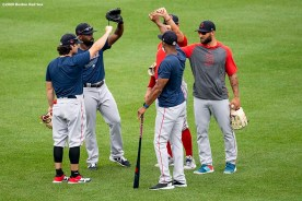 BOSTON, MA - JULY 8: Members of the Boston Red Sox outfield react during a summer camp workout before the start of the 2020 Major League Baseball season on July 8, 2020 at Fenway Park in Boston, Massachusetts. The season was delayed due to the coronavirus pandemic. (Photo by Billie Weiss/Boston Red Sox/Getty Images) *** Local Caption ***