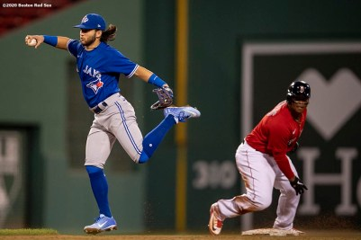 BOSTON, MA - JULY 21: Bo Bichette #11 of the Toronto Blue Jays leaps as he attempts to turn a double play as Rafael Devers #11 of the Boston Red Sox slides during the fourth inning of an exhibition game before the start of the 2020 Major League Baseball season on July 21, 2020 at Fenway Park in Boston, Massachusetts. The season was delayed due to the coronavirus pandemic. (Photo by Billie Weiss/Boston Red Sox/Getty Images) *** Local Caption *** Bo Bichette; Rafael Devers