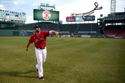 BOSTON, MA - JULY 22: Mitch Moreland #18 of the Boston Red Sox reacts as he tosses a resistance band before an exhibition game against the Toronto Blue Jays before the start of the 2020 Major League Baseball season on July 22, 2020 at Fenway Park in Boston, Massachusetts. The season was delayed due to the coronavirus pandemic. (Photo by Billie Weiss/Boston Red Sox/Getty Images) *** Local Caption *** Mitch Moreland