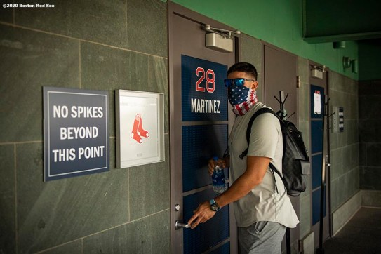 BOSTON, MA - JULY 24: J.D. Martinez #28 of the Boston Red Sox arrives before the Opening Day game against the Baltimore Orioles on July 24, 2020 at Fenway Park in Boston, Massachusetts. The 2020 season had been postponed since March due to the COVID-19 pandemic. (Photo by Billie Weiss/Boston Red Sox/Getty Images) *** Local Caption *** J.D. Martinez