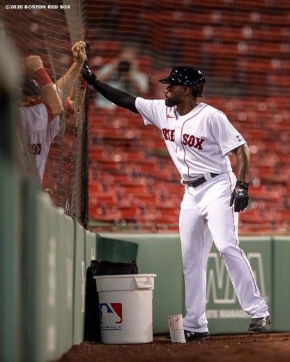 BOSTON, MA - JULY 24: Jackie Bradley Jr. #19 of the Boston Red Sox high fives teammates after scoring during the Opening Day game against the Baltimore Orioles on July 24, 2020 at Fenway Park in Boston, Massachusetts. The 2020 season had been postponed since March due to the COVID-19 pandemic. (Photo by Billie Weiss/Boston Red Sox/Getty Images) *** Local Caption *** Jackie Bradley Jr.