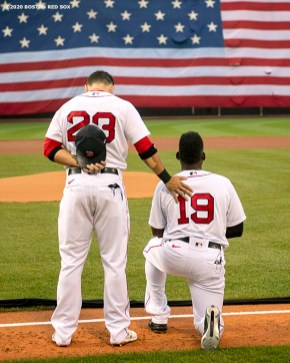 BOSTON, MA - JULY 24: Jackie Bradley Jr. #19 of the Boston Red Sox kneels during the National Anthem alongside Michael Chavis #23 during a pre-game ceremony before the Opening Day game against the Baltimore Orioles on July 24, 2020 at Fenway Park in Boston, Massachusetts. The 2020 season had been postponed since March due to the COVID-19 pandemic. (Photo by Billie Weiss/Boston Red Sox/Getty Images) *** Local Caption *** Jackie Bradley Jr.; Michael Chavis