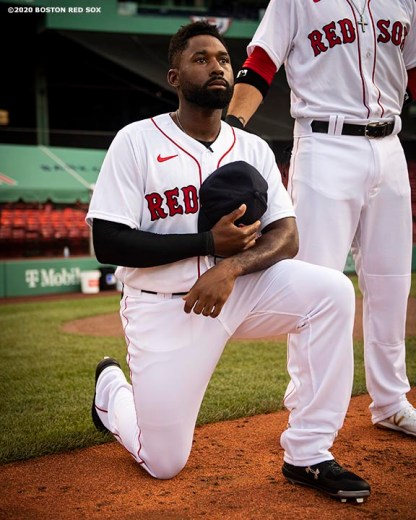 BOSTON, MA - JULY 24: Jackie Bradley Jr. #19 of the Boston Red Sox kneels during the National Anthem during a pre-game ceremony before the Opening Day game against the Baltimore Orioles on July 24, 2020 at Fenway Park in Boston, Massachusetts. The 2020 season had been postponed since March due to the COVID-19 pandemic. (Photo by Billie Weiss/Boston Red Sox/Getty Images) *** Local Caption *** Jackie Bradley Jr.