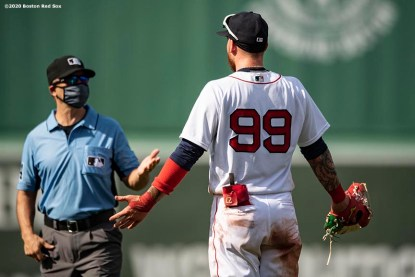 BOSTON, MA - JULY 25: Alex Verdugo #99 of the Boston Red Sox argues with umpire Mark Wegner during the ninth inning of a game against the Baltimore Orioles on July 25, 2020 at Fenway Park in Boston, Massachusetts. The Major League Baseball season was delayed due to the coronavirus pandemic. (Photo by Billie Weiss/Boston Red Sox/Getty Images) *** Local Caption *** Alex Verdugo; Mark Wegner