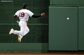 BOSTON, MA - JULY 27: Jackie Bradley Jr. #19 of the Boston Red Sox jumps after a line drive during the fourth inning of a game against the New York Mets on July 27, 2020 at Fenway Park in Boston, Massachusetts. The 2020 season had been postponed since March due to the COVID-19 pandemic. (Photo by Billie Weiss/Boston Red Sox/Getty Images) *** Local Caption *** Jackie Bradley Jr.