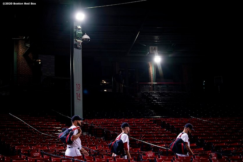 BOSTON, MA - JULY 28: Members of the Boston Red Sox walk through the seats after a loss to the the New York Mets on July 28, 2020 at Fenway Park in Boston, Massachusetts. The 2020 season had been postponed since March due to the COVID-19 pandemic. (Photo by Billie Weiss/Boston Red Sox/Getty Images) *** Local Caption ***
