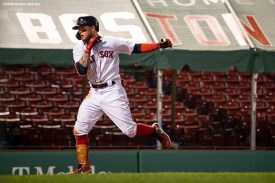 BOSTON, MA - AUGUST 7: Alex Verdugo #99 of the Boston Red Sox reacts after hitting a solo home run during the eighth inning of a game against the Toronto Blue Jays on August 7, 2020 at Fenway Park in Boston, Massachusetts. It was his second home run of the game. The 2020 season had been postponed since March due to the COVID-19 pandemic. (Photo by Billie Weiss/Boston Red Sox/Getty Images) *** Local Caption *** Alex Verdugo