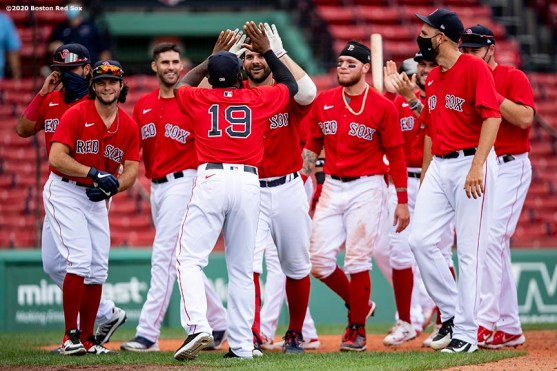 BOSTON, MA - AUGUST 9: Mitch Moreland #18 of the Boston Red Sox reacts with teammates after hitting a game winning walk-off two run home run during the ninth inning of a game against the Toronto Blue Jays on August 9, 2020 at Fenway Park in Boston, Massachusetts. It was his second home run of the day. The 2020 season had been postponed since March due to the COVID-19 pandemic. (Photo by Billie Weiss/Boston Red Sox/Getty Images) *** Local Caption *** Mitch Moreland