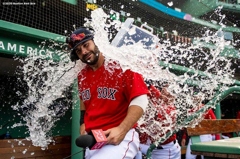 BOSTON, MA - AUGUST 9: Mitch Moreland #18 of the Boston Red Sox is doused with water after hitting a game winning walk-off two run home run during the ninth inning of a game against the Toronto Blue Jays on August 9, 2020 at Fenway Park in Boston, Massachusetts. It was his second home run of the day. The 2020 season had been postponed since March due to the COVID-19 pandemic. (Photo by Billie Weiss/Boston Red Sox/Getty Images) *** Local Caption *** Mitch Moreland
