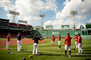 BOSTON, MA - AUGUST 10: Members of the Boston Red Sox stretch before a game against the Tampa Bay Rays on August 10, 2020 at Fenway Park in Boston, Massachusetts. The 2020 season had been postponed since March due to the COVID-19 pandemic. (Photo by Billie Weiss/Boston Red Sox/Getty Images) *** Local Caption ***