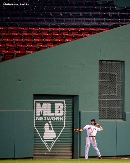 BOSTON, MA - AUGUST 11: Andrew Benintendi #16 of the Boston Red Sox throws during the third inning of a game against the Tampa Bay Rays on August 11, 2020 at Fenway Park in Boston, Massachusetts. The 2020 season had been postponed since March due to the COVID-19 pandemic. (Photo by Billie Weiss/Boston Red Sox/Getty Images) *** Local Caption *** Andrew Benintendi
