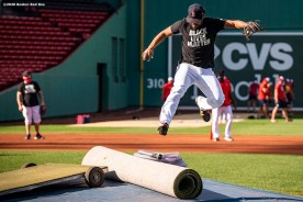 BOSTON, MA - AUGUST 28: Xander Bogaerts #2 of the Boston Red Sox jumps over the mound as he wears a Black Lives Matter shirt before a game against the Washington Nationals on August 28, 2020 at Fenway Park in Boston, Massachusetts. The 2020 season had been postponed since March due to the COVID-19 pandemic. (Photo by Billie Weiss/Boston Red Sox/Getty Images) *** Local Caption *** Xander Bogaerts
