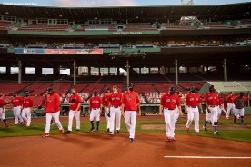 BOSTON, MA - AUGUST 28: Members of the Boston Red Sox line up ahead of the National Anthem before a game against the Washington Nationals on August 28, 2020 at Fenway Park in Boston, Massachusetts. The 2020 season had been postponed since March due to the COVID-19 pandemic. (Photo by Billie Weiss/Boston Red Sox/Getty Images) *** Local Caption ***