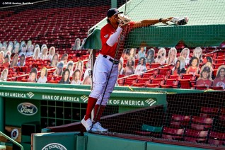 BOSTON, MA - AUGUST 30: Xander Bogaerts #2 of the Boston Red Sox retrieves his cleats from the roof of the auxiliary extended dugout before a game against the Washington Nationals on August 30, 2020 at Fenway Park in Boston, Massachusetts. The 2020 season had been postponed since March due to the COVID-19 pandemic. (Photo by Billie Weiss/Boston Red Sox/Getty Images) *** Local Caption *** Xander Bogaerts