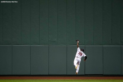 BOSTON, MA - AUGUST 31: Jackie Bradley Jr. #19 of the Boston Red Sox leaps as he catches a fly ball during the third inning of a game against the Atlanta Braves on August 31, 2020 at Fenway Park in Boston, Massachusetts. The 2020 season had been postponed since March due to the COVID-19 pandemic. (Photo by Billie Weiss/Boston Red Sox/Getty Images) *** Local Caption *** Jackie Bradley Jr.