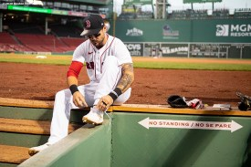 BOSTON, MA - SEPTEMBER 1: Michael Chavis #23 of the Boston Red Sox ties his shoes before a game against the Atlanta Braves on September 1, 2020 at Fenway Park in Boston, Massachusetts. The 2020 season had been postponed since March due to the COVID-19 pandemic. (Photo by Billie Weiss/Boston Red Sox/Getty Images) *** Local Caption *** Michael Chavis