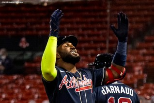 BOSTON, MA - SEPTEMBER 1: Marcell Ozuna #20 of the Atlanta Braves reacts after hitting a home run during the eighth inning of a game against the Boston Red Sox on September 1, 2020 at Fenway Park in Boston, Massachusetts. It was his third home run of the game. The 2020 season had been postponed since March due to the COVID-19 pandemic. (Photo by Billie Weiss/Boston Red Sox/Getty Images) *** Local Caption *** Marcell Ozuna