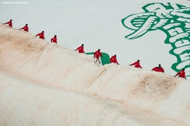 BOSTON, MA - SEPTEMBER 2: Members of the grounds crew remove the tarp before a game between the Boston Red Sox and the Atlanta Braves on September 2, 2020 at Fenway Park in Boston, Massachusetts. The 2020 season had been postponed since March due to the COVID-19 pandemic. (Photo by Billie Weiss/Boston Red Sox/Getty Images) *** Local Caption ***