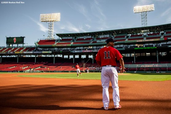 BOSTON, MA - SEPTEMBER 4: Rafael Devers #11 of the Boston Red Sox warms up before a game against the Toronto Blue Jays on September 4, 2020 at Fenway Park in Boston, Massachusetts. The 2020 season had been postponed since March due to the COVID-19 pandemic. (Photo by Billie Weiss/Boston Red Sox/Getty Images) *** Local Caption *** Rafael Devers