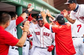 BOSTON, MA - SEPTEMBER 6: Kevin Plawecki #25 of the Boston Red Sox celebrates with teammates after hitting a three run home run during the first inning of a game against the Toronto Blue Jays on September 6, 2020 at Fenway Park in Boston, Massachusetts. The 2020 season had been postponed since March due to the COVID-19 pandemic. (Photo by Billie Weiss/Boston Red Sox/Getty Images) *** Local Caption *** Kevin Plawecki