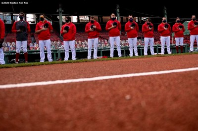 BOSTON, MA - SEPTEMBER 20: Members of the Boston Red Sox line up during the National Anthem before a game against the New York Yankees on September 20, 2020 at Fenway Park in Boston, Massachusetts. The 2020 season had been postponed since March due to the COVID-19 pandemic. (Photo by Billie Weiss/Boston Red Sox/Getty Images) *** Local Caption ***