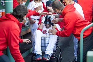 BOSTON, MA - SEPTEMBER 20: J.D. Martinez #28 of the Boston Red Sox is pushed in a cart after hitting a home run during the eight inning of a game against the New York Yankees on September 20, 2020 at Fenway Park in Boston, Massachusetts. The 2020 season had been postponed since March due to the COVID-19 pandemic. (Photo by Billie Weiss/Boston Red Sox/Getty Images) *** Local Caption *** J.D. Martinez