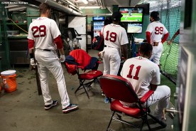 BOSTON, MA - SEPTEMBER 23: J.D. Martinez #28, Jackie Bradley Jr. #19, Rafael Devers #11, and Alex Verdugo #99 of the Boston Red Sox watch a game on television in the batting cage before a game against the Baltimore Orioles on September 23, 2020 at Fenway Park in Boston, Massachusetts. The 2020 season had been postponed since March due to the COVID-19 pandemic. (Photo by Billie Weiss/Boston Red Sox/Getty Images) *** Local Caption *** J.D. Martinez; Rafael Devers; Jackie Bradley Jr.; Alex Verdugo