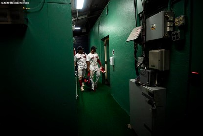 BOSTON, MA - SEPTEMBER 23: Xander Bogaerts #2 and Rafael Devers #11 of the Boston Red Sox walk through the tunnel after a game against the Baltimore Orioles on September 23, 2020 at Fenway Park in Boston, Massachusetts. The 2020 season had been postponed since March due to the COVID-19 pandemic. (Photo by Billie Weiss/Boston Red Sox/Getty Images) *** Local Caption *** Xander Bogaerts; Rafael Devers