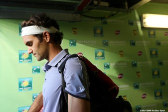 """Roger Federer walks out of the tunnel before playing Tommy Haas at the 2014 BNP Paribas Open Wednesday, March 12, 2014 in Indian Wells, California."""