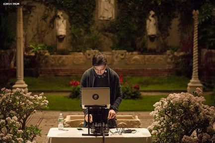 """DJ Ricardo De Lima plays music in the courtyard during a 'Winter Solstice' themed Third Thursdays at the Isabella Stewart Gardner Museum in Boston, Massachusetts Thursday, December 18, 2014."""