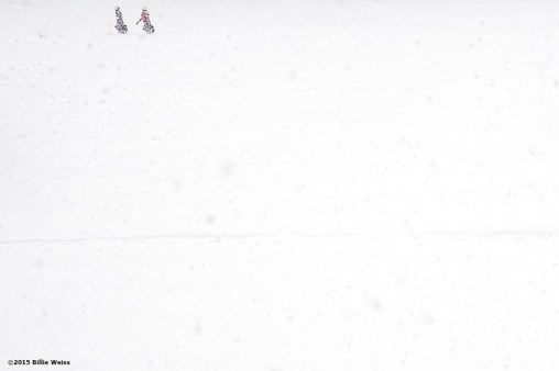 """People walk across a field in Amory Park during snow storm Juno in Brookline, Massachusetts Tuesday, January 27, 2015."""