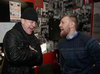 BOSTON, MA - JANUARY 09: UFC fighter Conor McGregor laughs with gym owner Peter Welch during a community event at Peter Welch's Gym on January 9, 2015 in Boston, Massachusetts. (Photo by Billie Weiss/Zuffa LLC/Zuffa LLC via Getty Images)