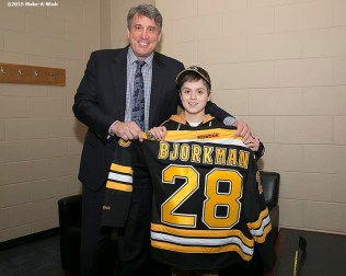 """Make-A-Wish recipient Jimmy Bjorkman of West Salem, Wisconsin meets Boston Bruins President Cam Neely and is presented with a jersey before a hockey game between the Boston Bruins and the Montreal Canadiens at TD Garden in Boston, Massachusetts Sunday, February 8, 2015."""