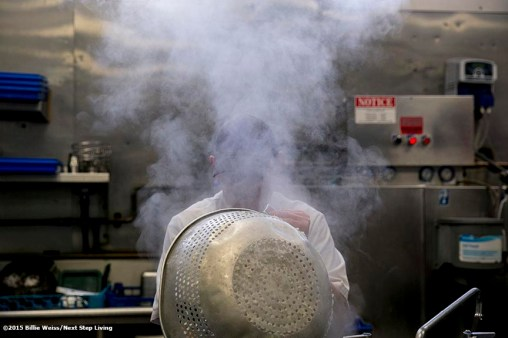 """A chef works in the kitchen of The Stockyard Steakhouse restaurant in Brighton, Massachusetts Tuesday, February 10, 2015."""