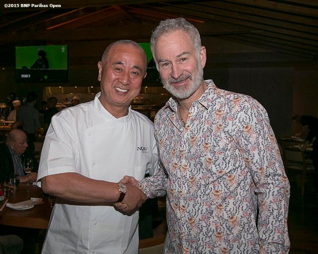 """John Mcenroe poses for a photograph with Nobu Matsuhisa in his restaurant, Nobu, during the McEnroe Challenge for Charity VIP Draw Ceremony in Stadium 2 at the Indian Wells Tennis Garden in Indian Wells, California Friday, March 6, 2015."""
