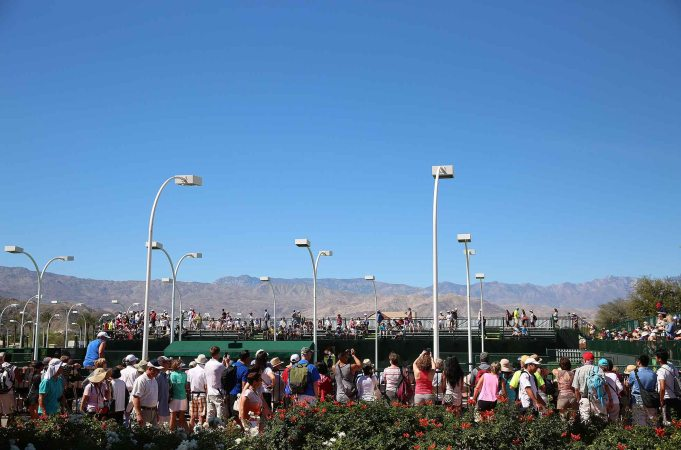 """Fans watch the doubles match action at Stadium 9 at the Indian Wells Tennis Garden in Indian Wells, California on Friday, March 13, 2015."""