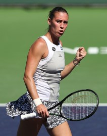 """Flavia Pennetta in action against Madison Bengle during their match at Stadium 1 at the Indian Wells Tennis Garden in Indian Wells, California on Saturday, March 14, 2015."""