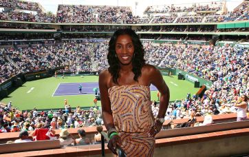 """Former WNBA star, Lisa Leslie, makes a suite appearance during the match between Sloane Stephens and Serena Williams inside stadium 1 at the Indian Wells Tennis Garden in Indian Wells, California on Tuesday, March 17, 2015."""