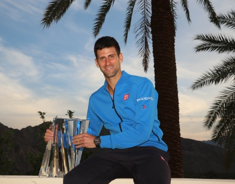 """Novak Djokovic poses with the Serbian flag following his victory in the Men's Singles Final of the 2015 BNP Paribas Open in Indian Wells, California on Sunday, March 22, 2015."""